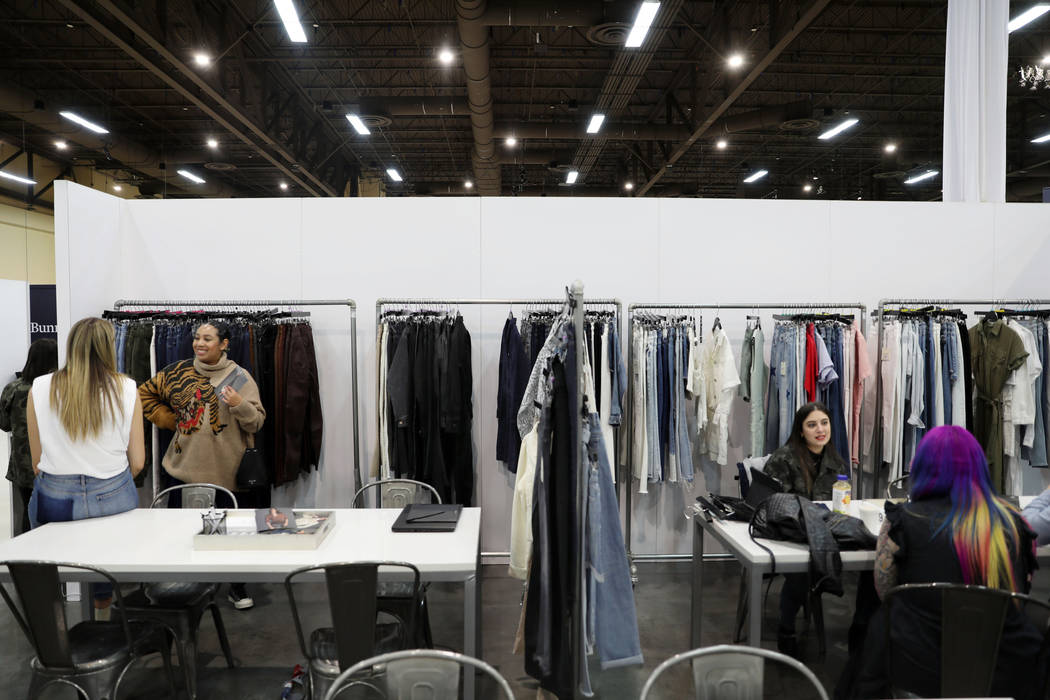 Sales are discussed at the DL1961 Premium Denim exhibit at the MAGIC fashion trade show at the ...