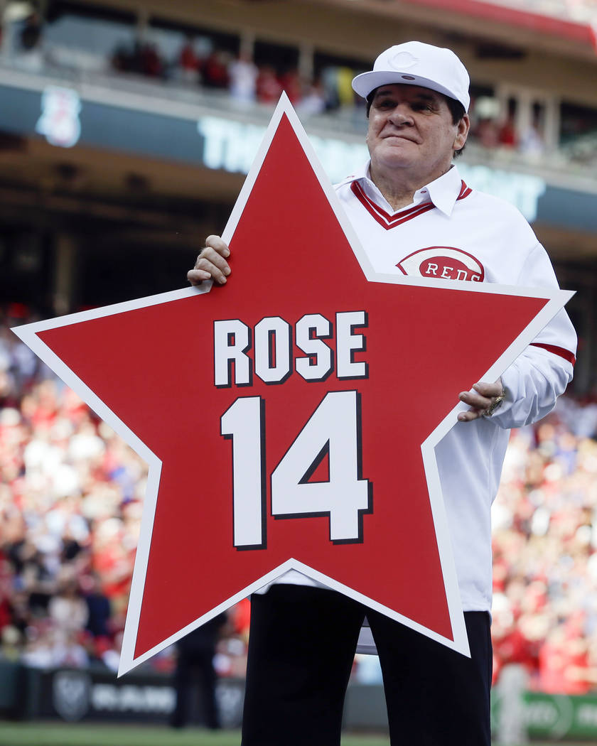 FILE -In this June 24, 2016, file photo, former Cincinnati Reds player Pete Rose (14) holds his ...