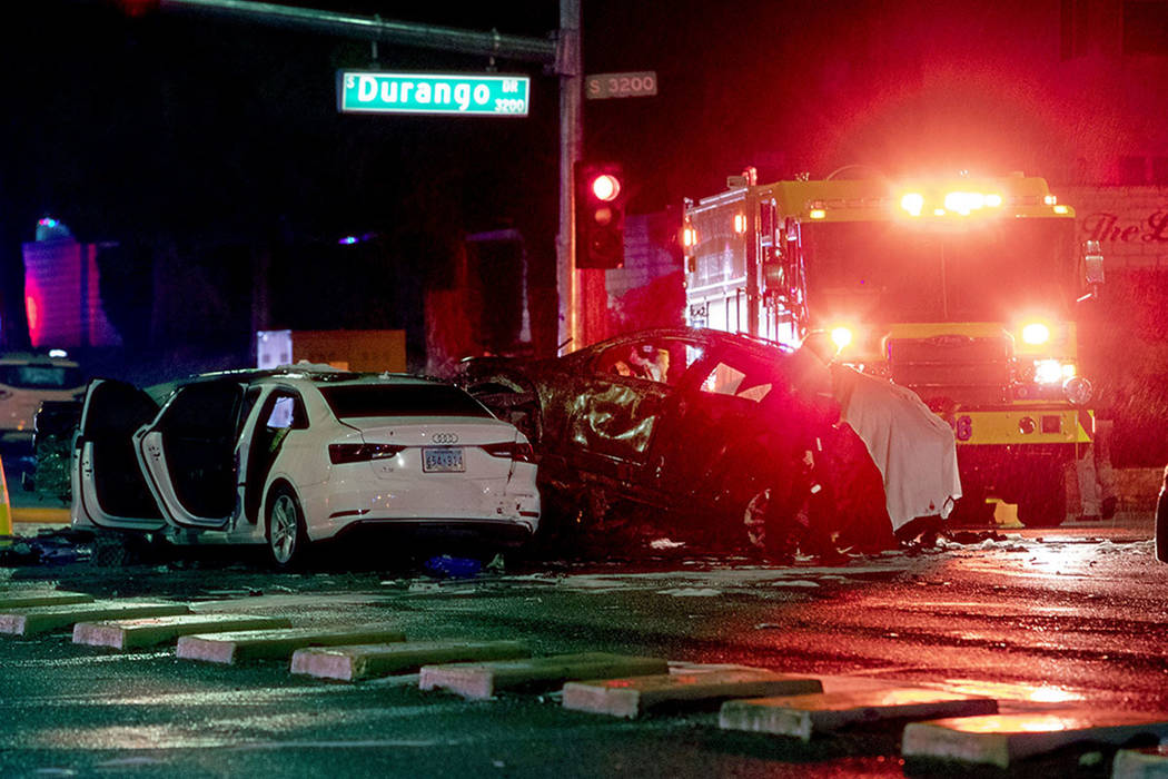 Police and fire crews investigate a fatal crash, Dec. 26, 2019, at the intersection of West Des ...