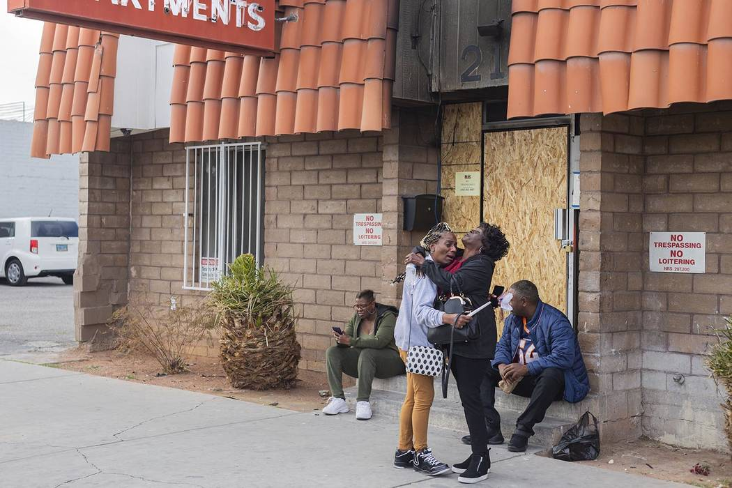 Displaced Alpine Motel Apartments tenants and employees mourn on Tuesday, Jan. 21, 2020 at the ...