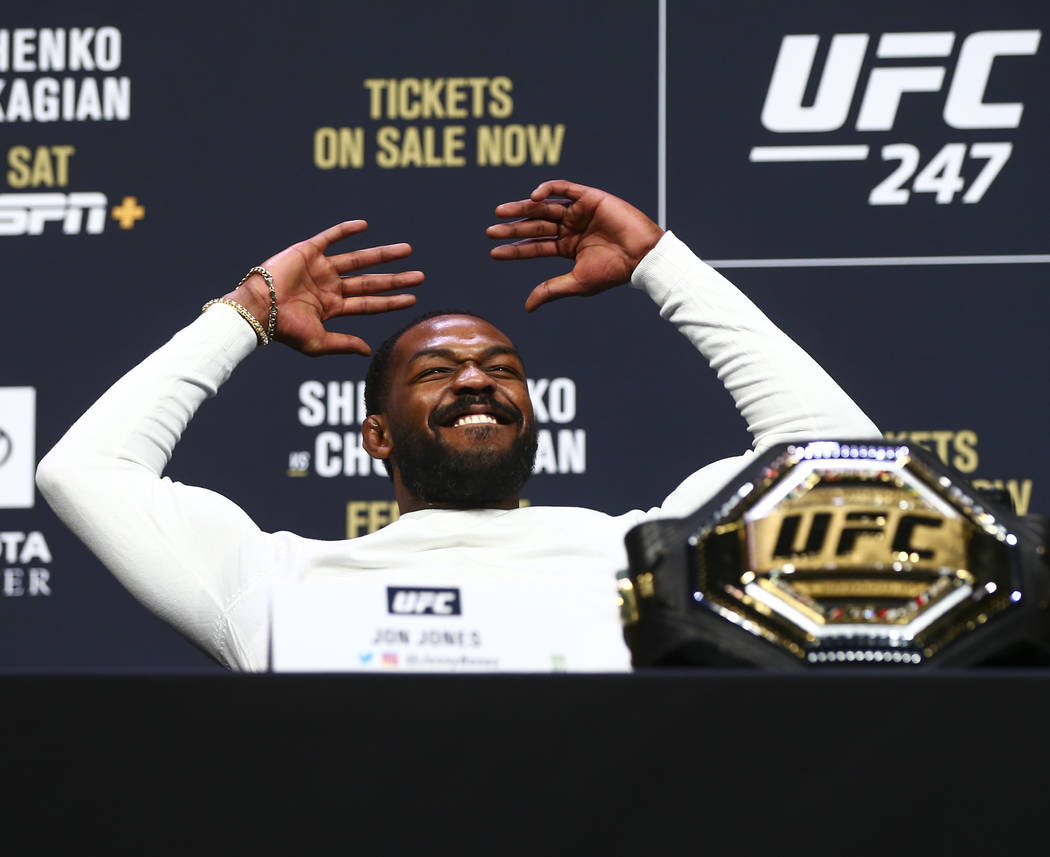 Jon Jones reacts during a press conference ahead of UFC 247, where he is slated to take on Domi ...