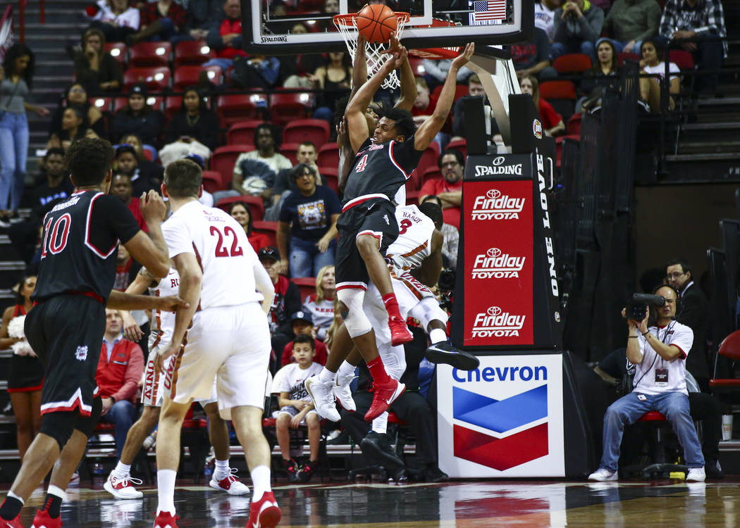UNLV's Bryce Hamilton (13) gets the rebound against Fresno State's Niven Hart (4) during the fi ...