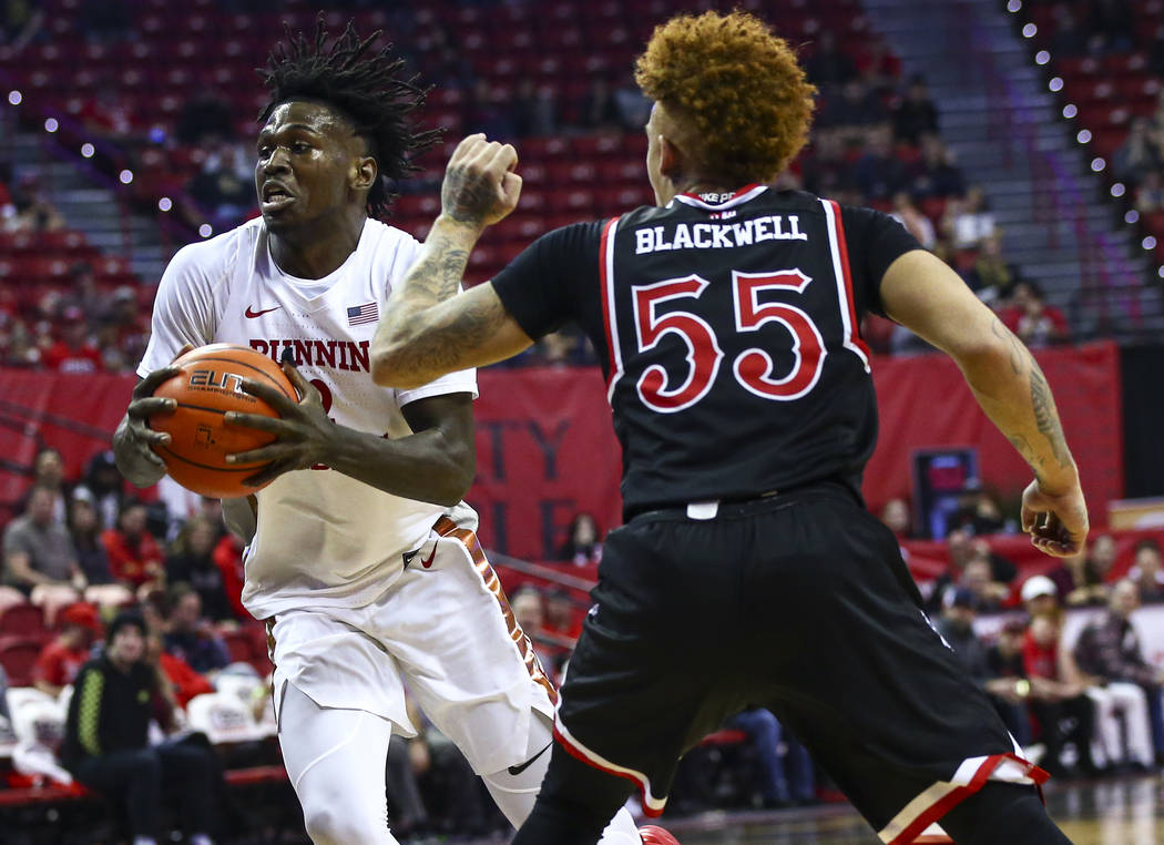 UNLV's Donnie Tillman (2) drives to the basket against Fresno State's Noah Blackwell (55) durin ...