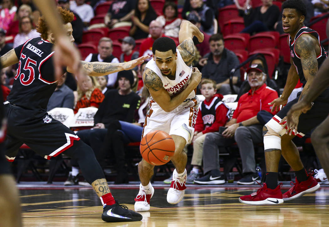 UNLV's Elijah Mitrou-Long (55) chases after the ball against Fresno State's Noah Blackwell (55) ...