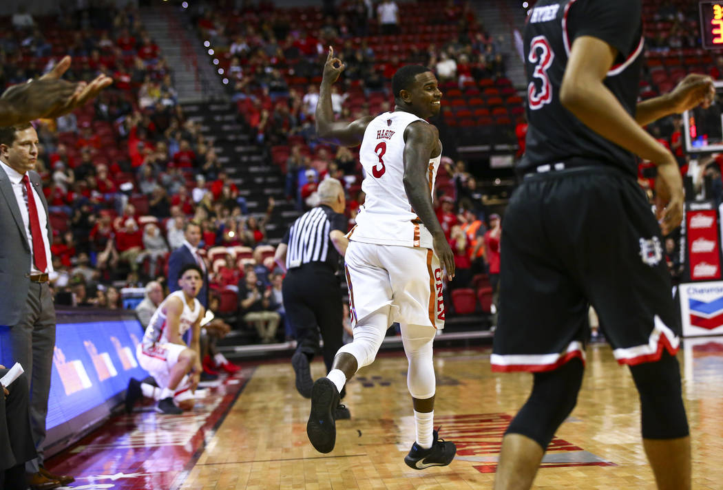 UNLV's guard Amauri Hardy (3) celebrates after scoring a three-pointer against Fresno State dur ...
