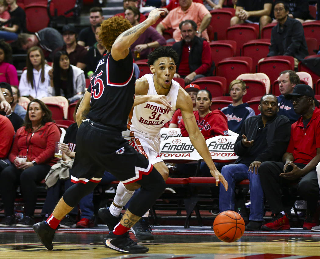 UNLV's Marvin Coleman (31) drives to the basket against Fresno State's Noah Blackwell (55) duri ...