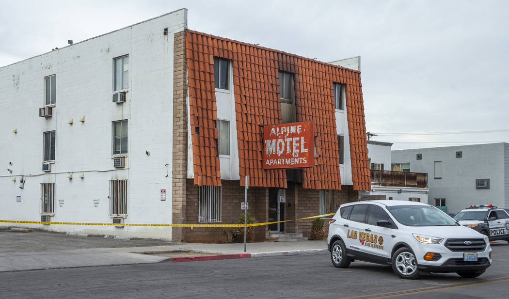 A Las Vegas Fire & Rescue vehicle is parked outside the Alpine Motel Apartments on Sunday, Dec. ...