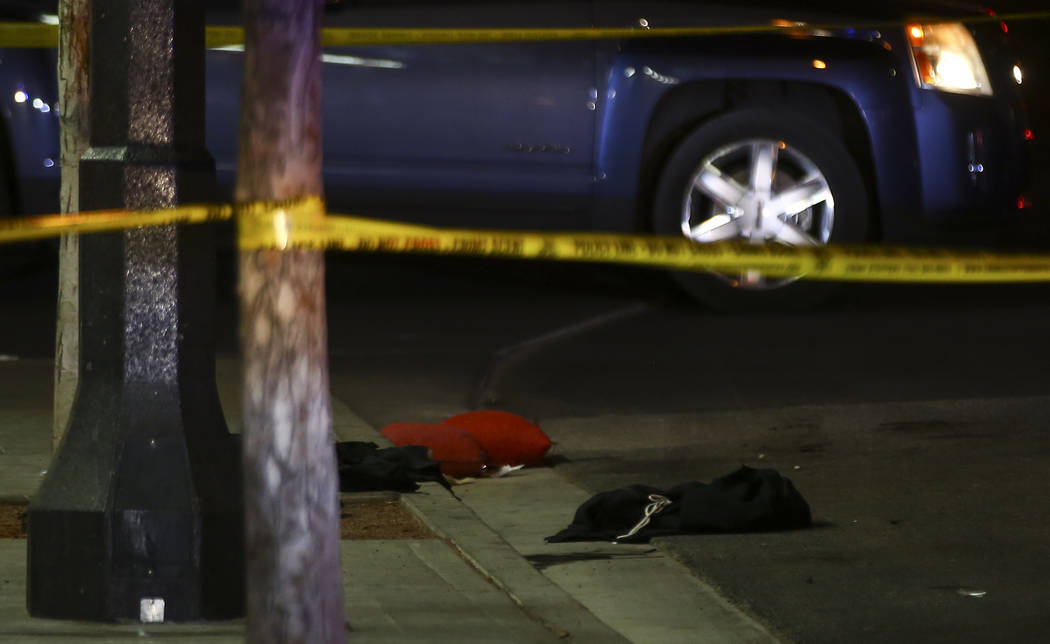 Clothes and other items on the ground at the scene of a shooting on Fremont Street between 14th ...