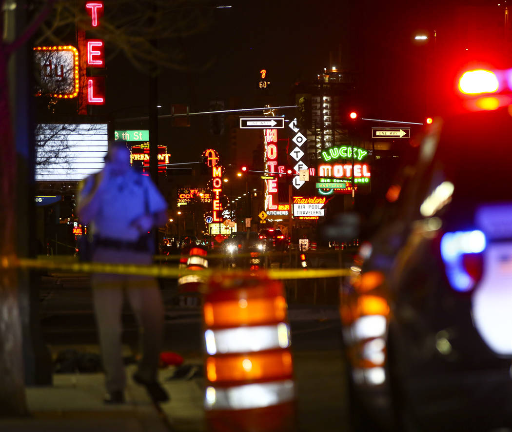 Las Vegas police officers investigate the scene of a shooting on Fremont Street between 14th an ...