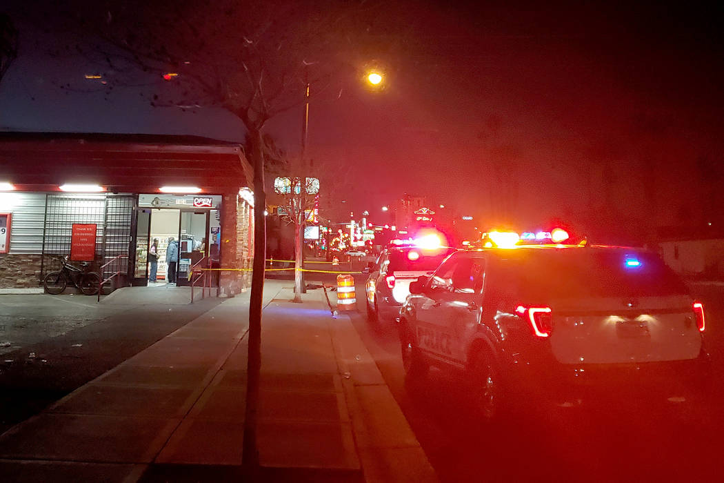 Police investigate a shooting, Thursday, Feb. 6, 2020, on Fremont Street near the 100 block of ...