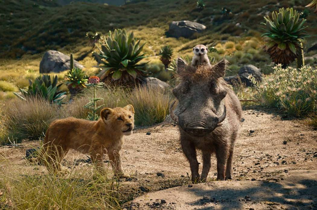This file image released by Disney shows, from left, young Simba, voiced by JD McCrary, Timon, ...