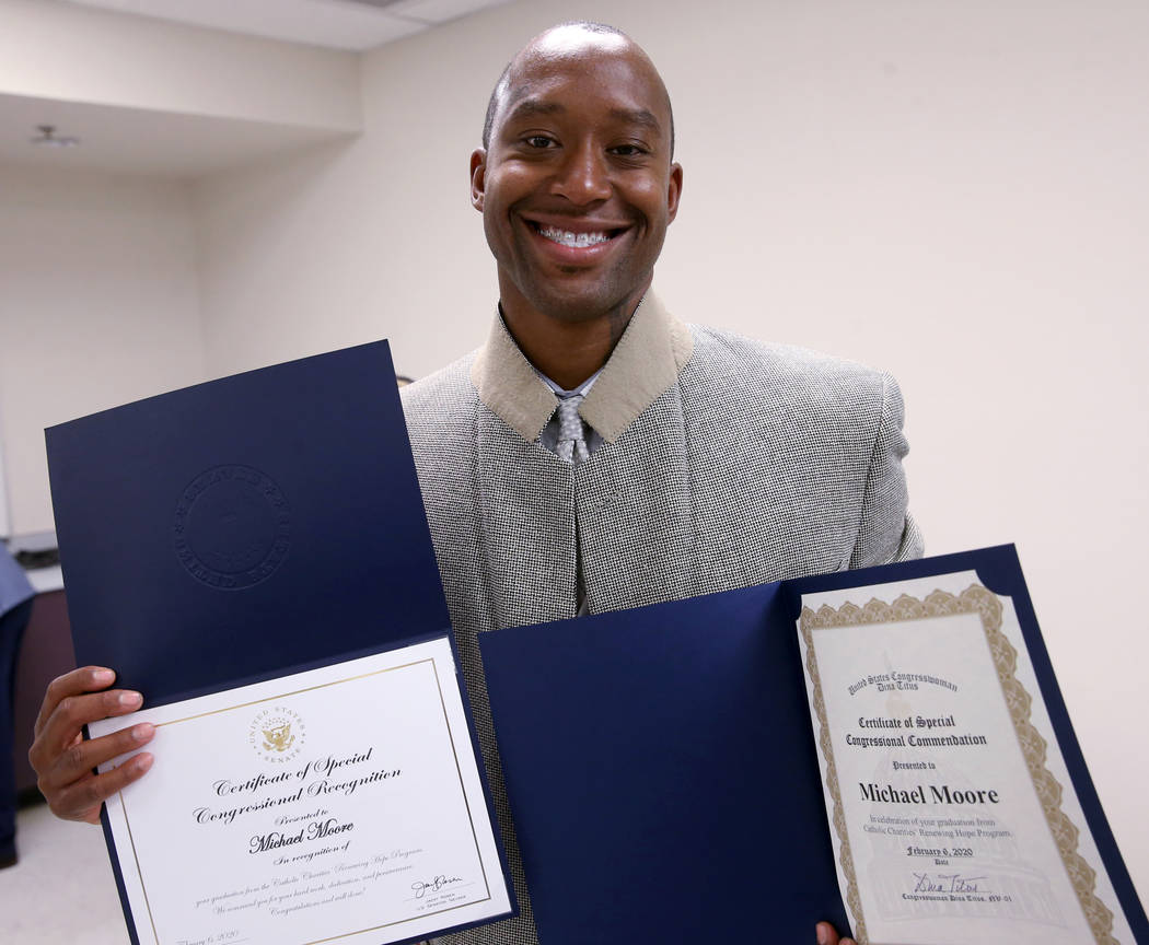 Michael Moore shows Congressional certificates during his Renewing Hope program graduation cere ...