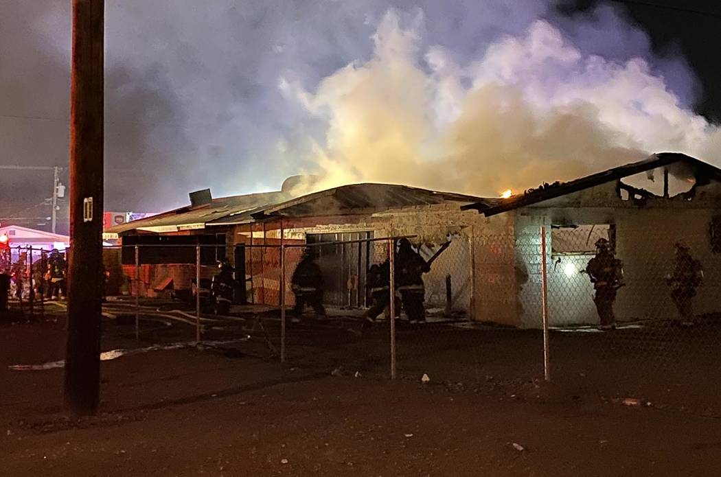 North Las Vegas firefighters battle a blaze at 2511 McCarran St. about 5 a.m. Friday, Feb. 7, 2 ...
