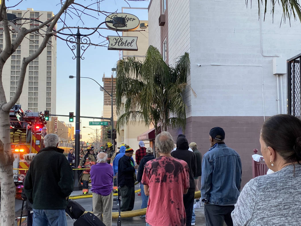 People evacuated from the Bridger Inn Motel, 301 N. Bridger St., watch firefighters after a fir ...