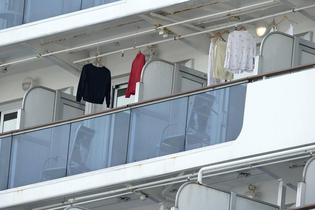 Clothes of passengers hang on the balcony of the cruise ship Diamond Princess anchored at Yokoh ...