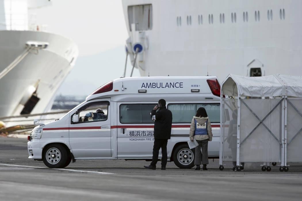 An ambulance arrives at the cruise ship Diamond Princess anchored at Yokohama Port in Yokohama, ...