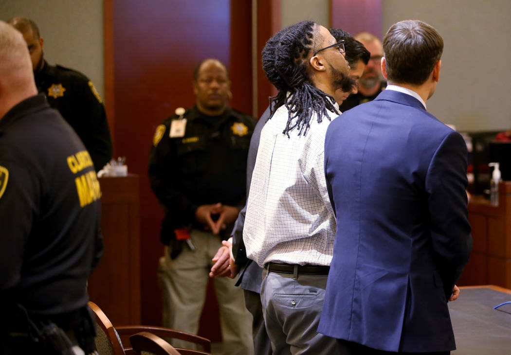 Ray Charles Brown reacts to a verdict of life with the possibility of parole flanked by his att ...