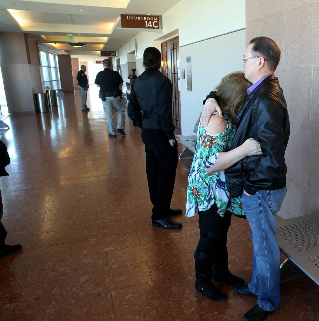 Dennis and Theresa Christensen, parents of murder victim Matthew Christensen, hug outside the c ...