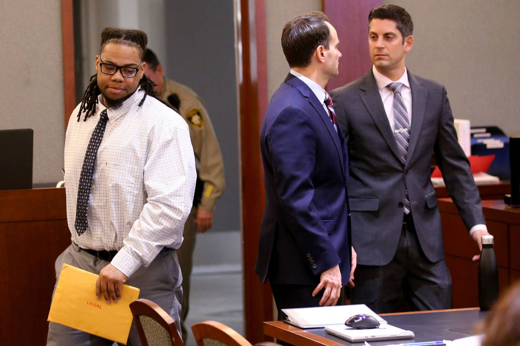 Ray Charles Brown, left, arrives in the courtroom with his attorneys, Richard Tanasi, right, an ...