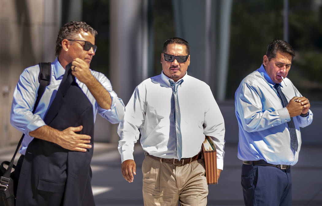 Attorney Mark Fleming, left, walks with defendant Albert Lopez outside the Lloyd George U.S. Co ...