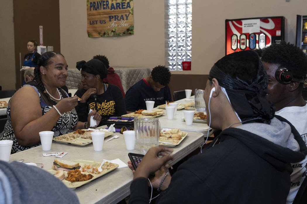 Jamie Brown, left, who has been in Las Vegas since April, eats dinner with family members at th ...