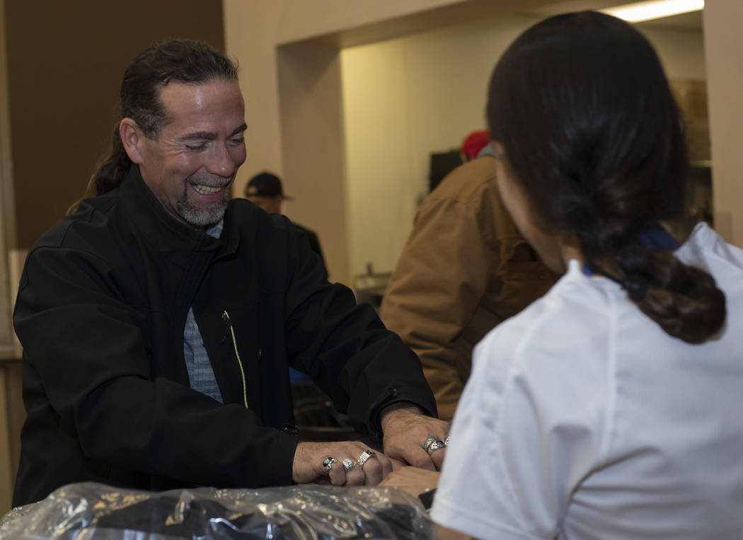 Bruce Thompson picks up his free CITYPAK backpack at the Las Vegas Rescue Mission on Saturday, ...