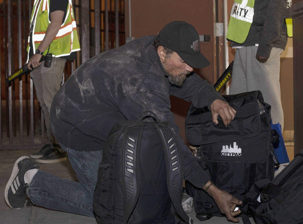 Shane Horton of Las Vegas closes his new CITYPAK backpack after filling it with his belongings ...