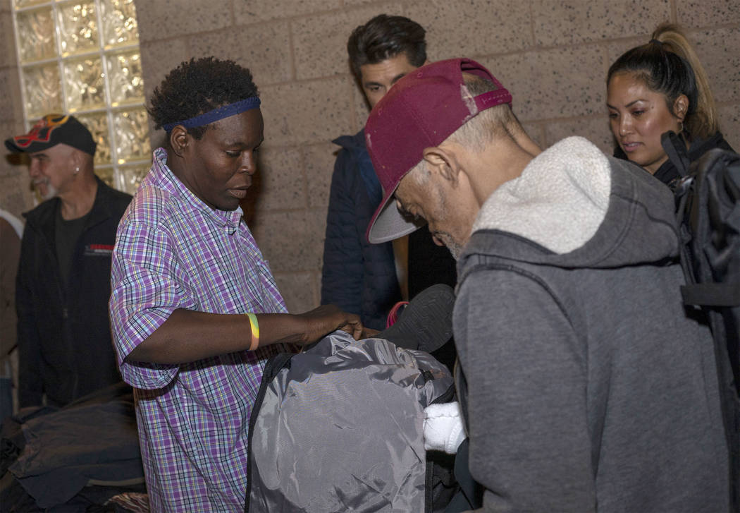 Linda Evans fills her new CITYPAK with donated clothing at the Las Vegas Rescue Mission on Satu ...