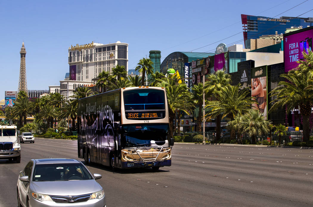 An RTC bus passes the New York-New York driving down the Strip on Tuesday, Aug. 13, 2019, in La ...