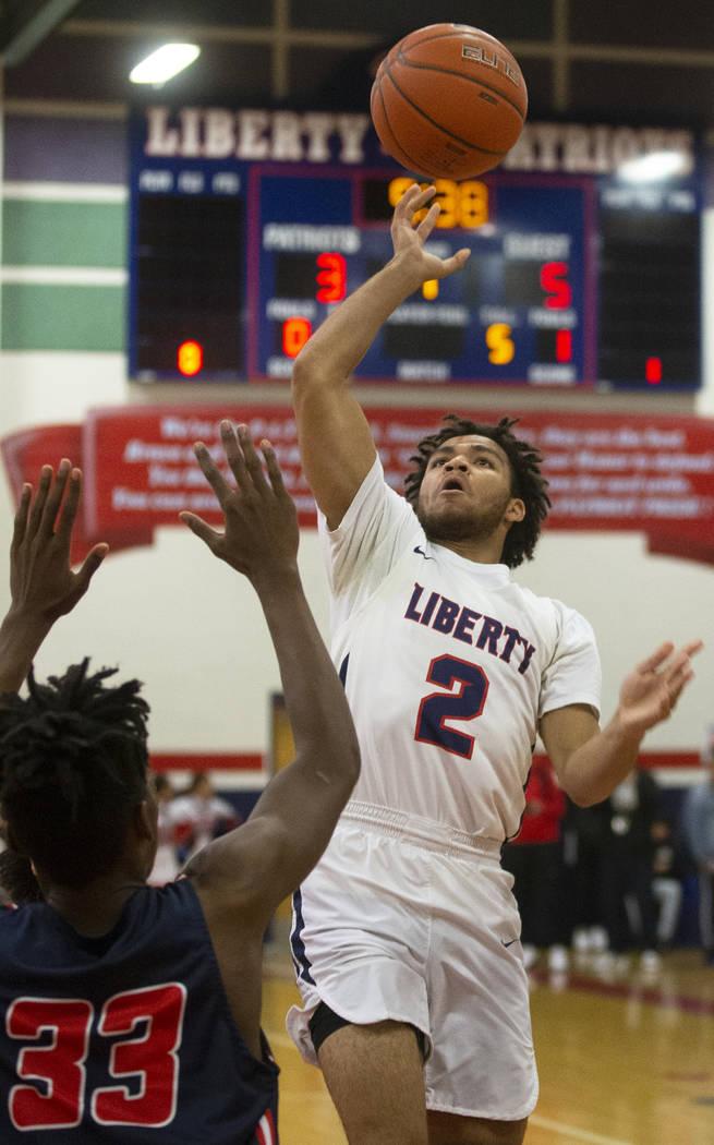 Liberty senior guard Dante' Davis (2) shoots a runner over Coronado sophomore forward Sargent J ...