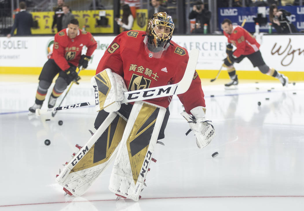 Vegas Golden Knights goaltender Marc-Andre Fleury (29) wears a jersey commemorating Chinese New ...