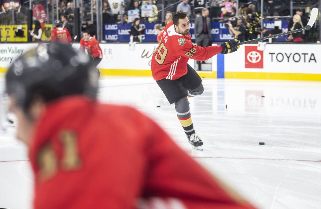 Vegas Golden Knights right wing Alex Tuch (89) wears a jersey commemorating Chinese New Year du ...