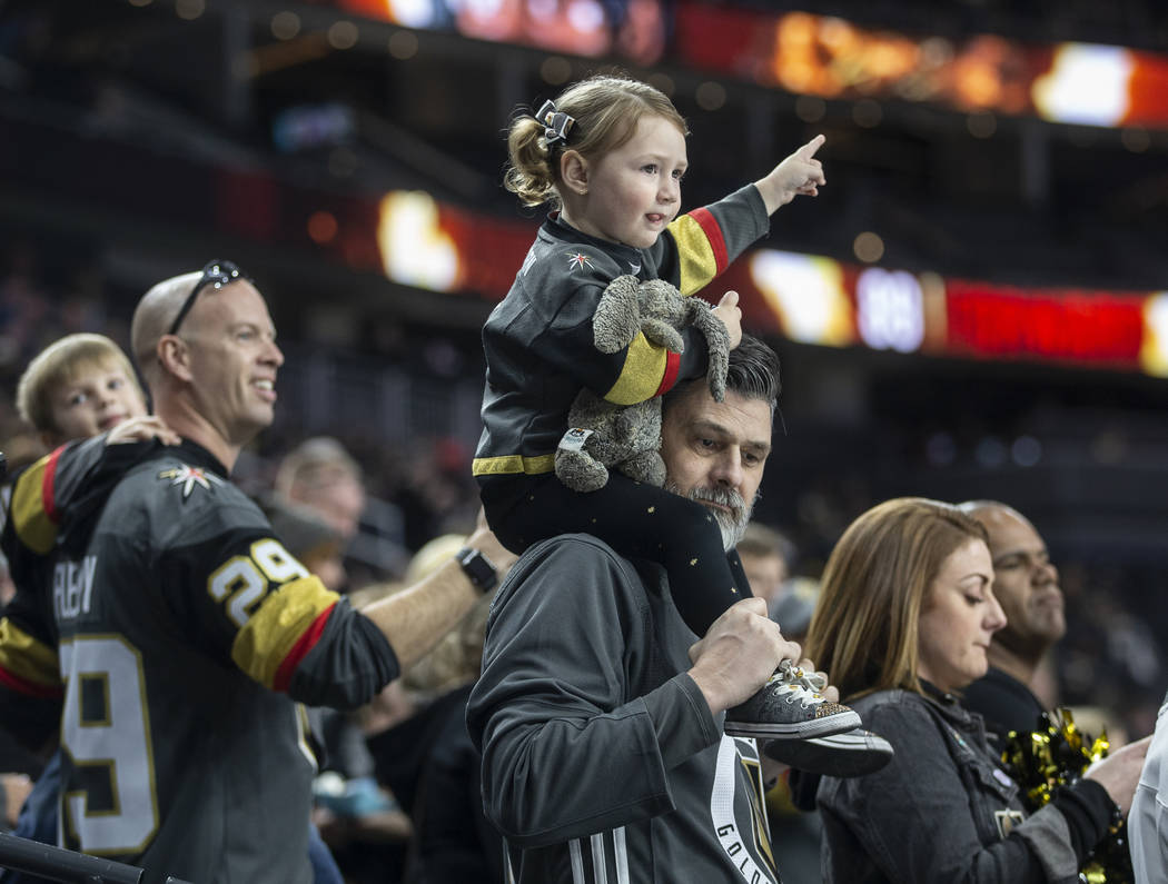 Goldens Knights fans cheer for Vegas before the start of their NHL hockey game with the Carolin ...