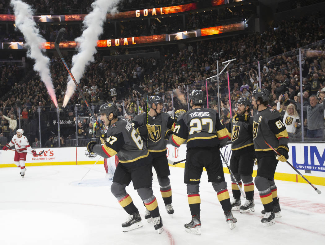 Vegas Golden Knights left wing Max Pacioretty (67) celebrates with teammates after scoring a fi ...
