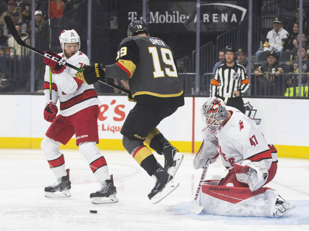 Vegas Golden Knights right wing Reilly Smith (19) tries to redirect a puck past Carolina Hurric ...