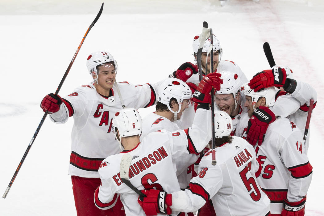Carolina Hurricanes players celebrate after beating the Golden Knights 6-5 in a shoutout during ...