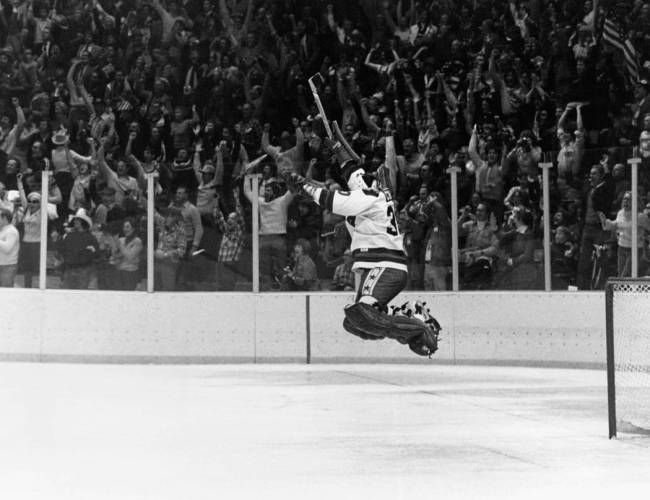 In this Feb. 22, 1980 file photo, U.S. Goalie James Craig leaps high in the air at the final se ...
