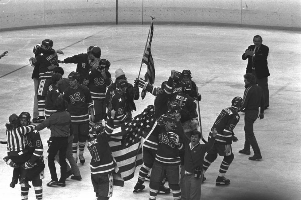 In this Feb. 24, 1980 file photo, members of the U.S. Olympic ice hockey team whoop it up on ic ...