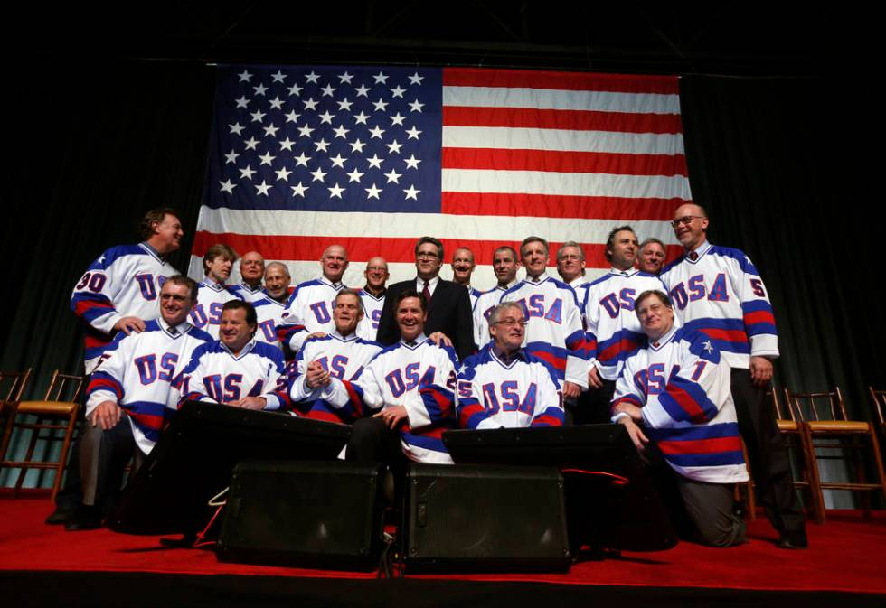 """Members of the 1980 U.S. ice hockey team pose for photos after a """"Relive the Miracle"""" ..."""
