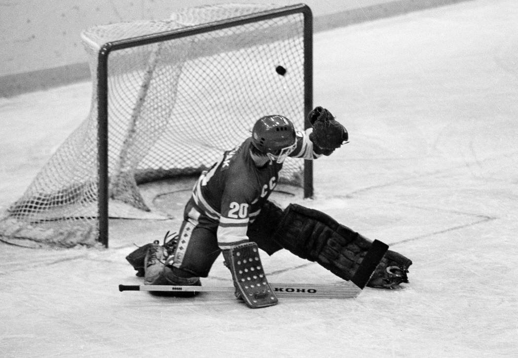 FILE - In this 1980 file photo, Soviet goalie Vladislav Tretiak allows a goal by the U.S. team ...