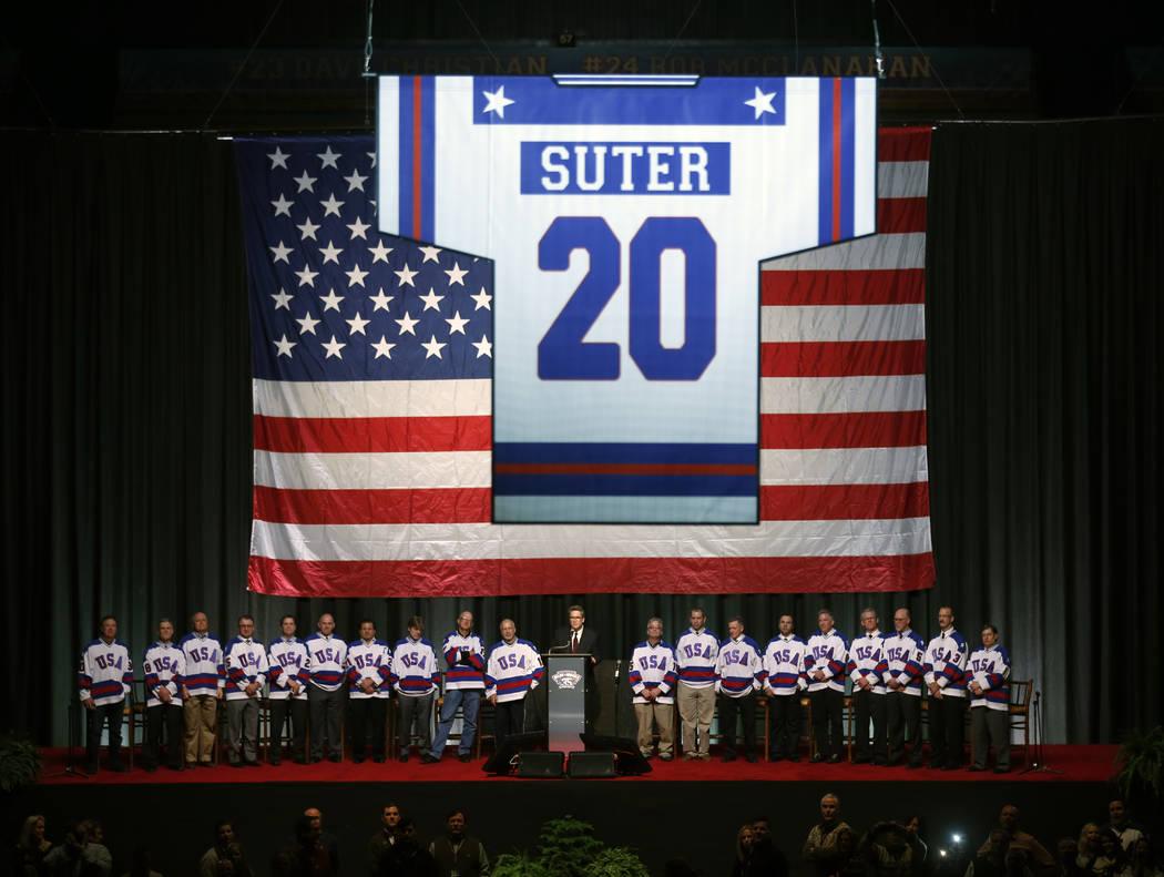Surviving members of the 1980 U.S. ice hockey team watch as the number of deceased teammate Bob ...
