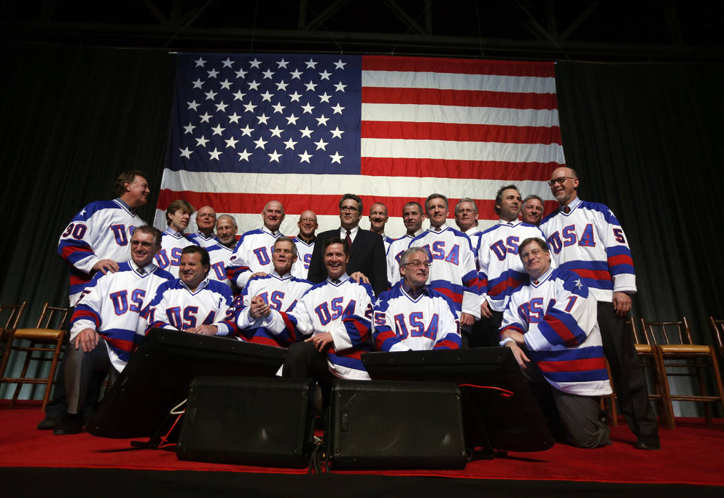 """Members of the 1980 U.S. ice hockey team pose for photos after a """"Relive the Miracle"""" reunion a ..."""