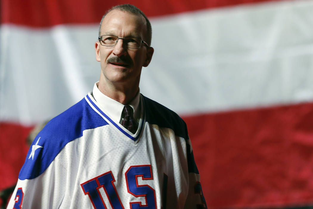 """Ken Morrow of the 1980 U.S. ice hockey team walks on stage during a """"Relive the Miracle&qu ..."""