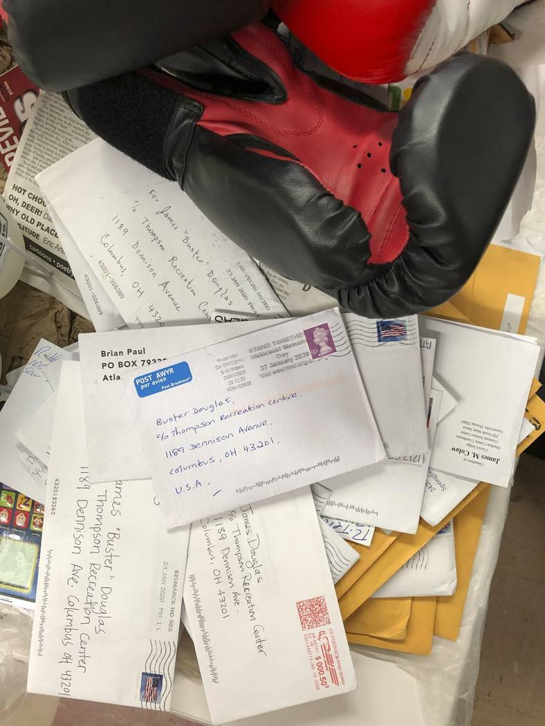 """In this Jan. 31, 2020 photo, a stack of fan mail for James """"Buster"""" Douglas, the form ..."""