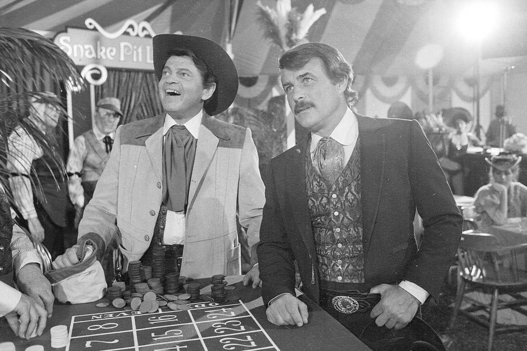 Actors Ross Martin, left, and Robert Conrad, right, are shown while filming a scene of the moti ...