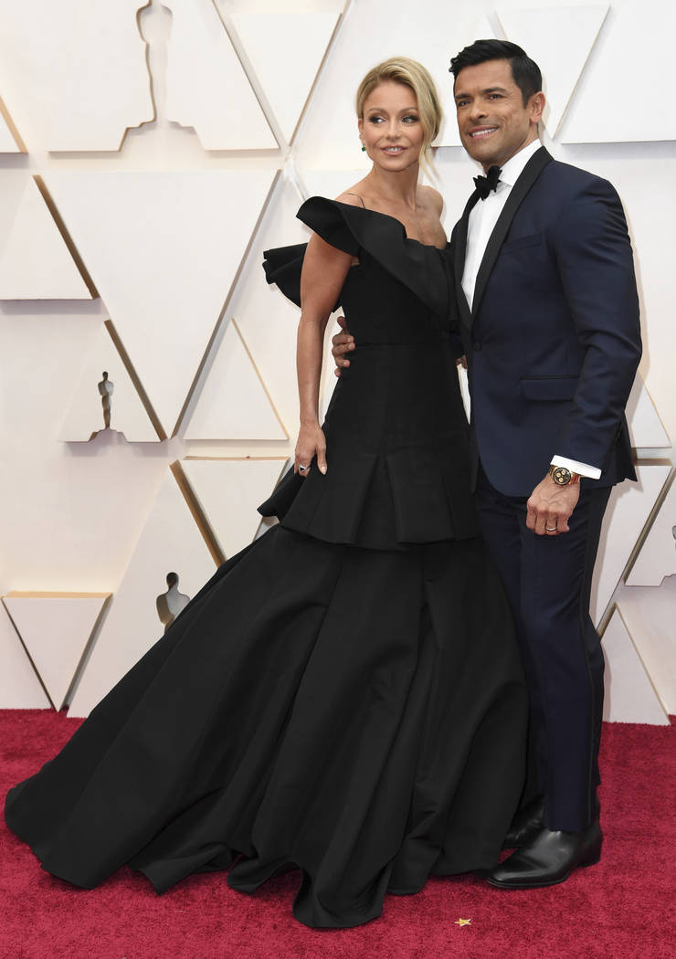 Kelly Ripa, left, and Mark Consuelos arrive at the Oscars on Sunday, Feb. 9, 2020, at the Dolby ...