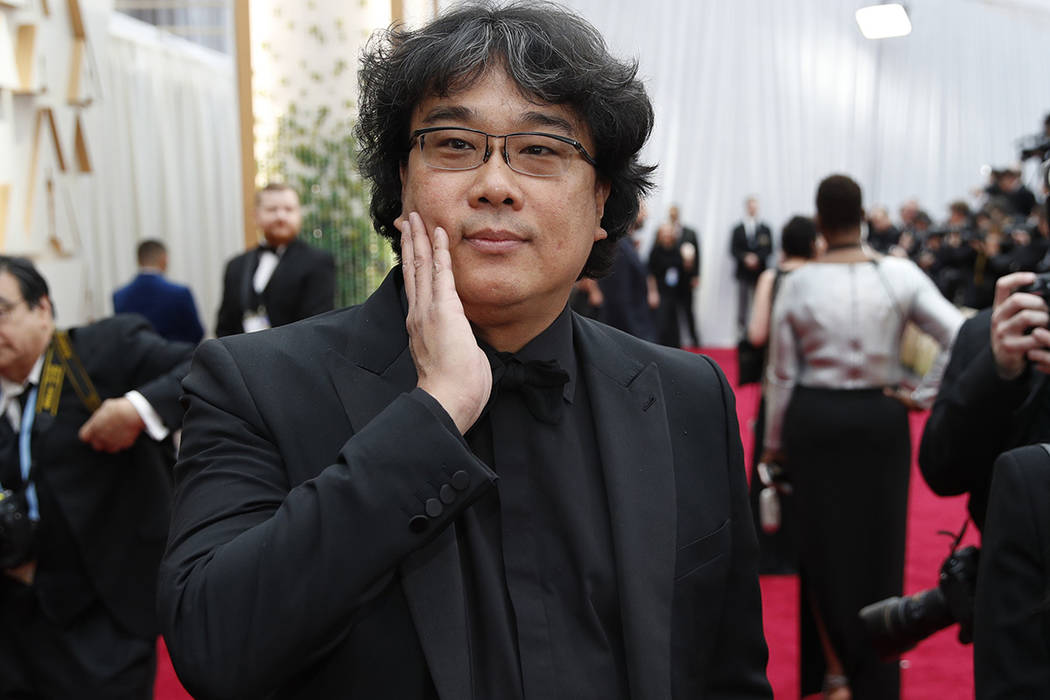Bong Joon-ho arrives at the Oscars on Sunday, Feb. 9, 2020, at the Dolby Theatre in Los Angeles ...