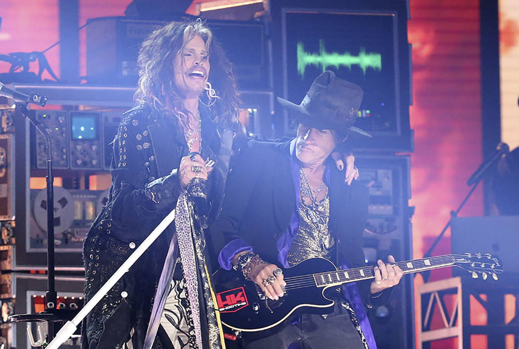 Steven Tyler, left, and Joe Perry, of Aerosmith, perform at the 62nd annual Grammy Awards on Su ...