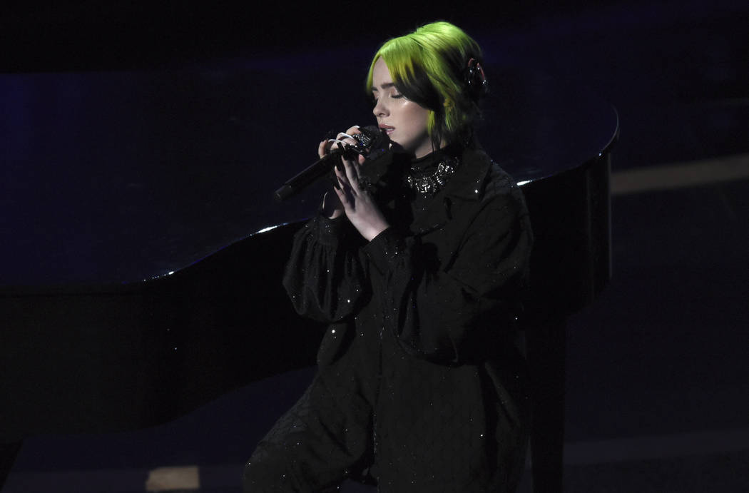 Billie Eilish performs during the in memoriam tribute at the Oscars on Sunday, Feb. 9, 2020, at ...