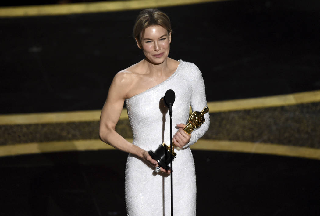 Renee Zellweger accepts the award for best performance by an actress in a leading role for &quo ...